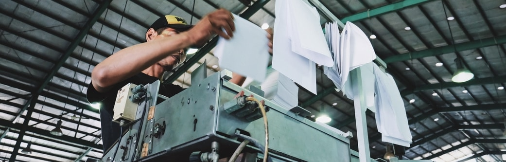 work instructions being printed in a factory